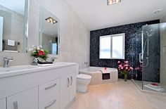 Bisazza Feature wall with Travertino white tile