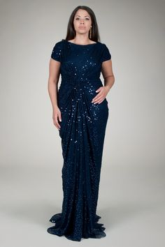 """Not repinning this because I like the dress...repinning because they call her """"plus size"""". Did I miss something? Should we start calling the """"normal"""" models """"mini sized""""??? Red Carpet Sequin Gown in Navy - Plus Size Evening Shop 