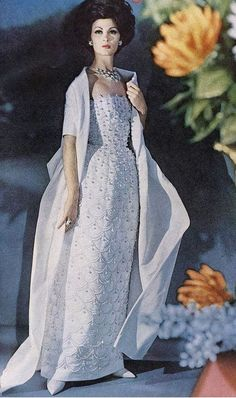 1961 Isabella in lovely white 'peau de soie' evening gown embroidered in rhinestones and tassled pearl beads by Sophie for Saks Fifth Avenue