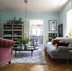 sitting room with blue walls in an eclectic 19th century Swedish house
