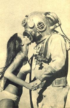 Woman kissing Diver with Suit.