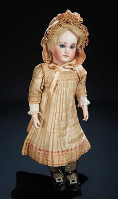 Marks: 136 9. Comments: Sonneberg,the doll was an attempt to capture the French market,having a body which closely copies the Bru kid bebe body,mystery maker; the model was also made with composition body (see lot #113). Value Points: beautiful child doll with very sturdy original body,perfect hands,lovely bisque,nice antique costume.
