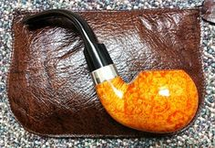 The Peterson Le Strade -- What I would consider probably the most beautiful factory produced pipe I can imagine. The form, function balance are all perfect.  I know there are more perfect factory pipes available and more beautiful artisan pipes available but for a factory pipe these sweeties are the cat's pajamas in my book...especially if you can find one with a Silver rim and a spigot mount...oh my.