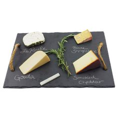 Slate cheese board with hemp rope handles and food-safe soapstone chalk.  Product: Cheese boardConstruction Material...