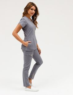 The Tulip Top in Graphite is a contemporary addition to women's medical scrub outfits. Shop Jaanuu for scrubs, lab coats and other medical apparel. Scrubs Outfit, Scrubs Uniform, Medical Scrubs, Dental Scrubs, Nursing Scrubs, Stylish Scrubs, Medical Uniforms, Nursing Uniforms, Cute Scrubs