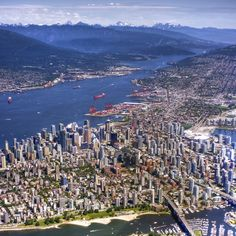 Vancouver, looking north east at downtown, Burrard Inlet harbour, North Vancouver and the Coast Mountains  by Evan Leeson