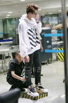 kris @ an airport #exo For once. I have an airport checker job so bad