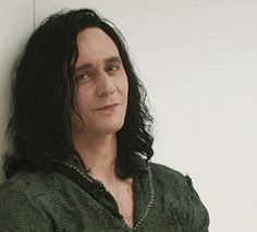 """itsthehiddlethings: """"When do we start?"""" Loki must be bored out of his mind in there. I know we can't see his whole cell from the trailer but we can see some of it and it's bare. It's a stark, white cell with no distinguishing features. We can see what looks like a couple of books on the table and a carafe of liquid but there's nothing else. That must be like torture for him. He needs stimulation. He needs something for his mind to work on. He's a trickster, he's used to thinking 20 moves…"""