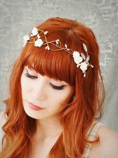 Wedding hair crown, floral tiara, bridal hair piece, white flower crown, hair accessories. $45.00, via Etsy.