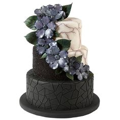 This dark and mysterious cake is an unforgettable way to tell your haunted Halloween love story. Make the cascade of shadowy flowers with our gum paste flowers set and draw the cracked marble pattern on the fondant cakes with black FoodWriter edible color marker. It's one Wicked Wedlock Halloween Wedding cake.