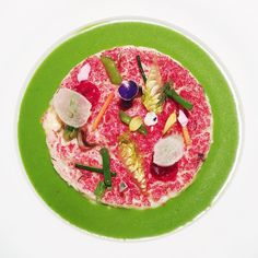 """The most colorful risotto ever w/ seasonal vegetables, vegetable puree, semi-cooked ""maccagno"" cheese, and raspberry powder by @chefantonioguida at the…"""