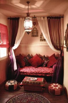 Bohemian Style - Easily re-create this nook by suspending curtain rods from the ceiling.