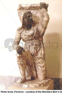 The statue is of a Kneeling Persian, made of pavonazzetto (known as breccia from Phrygia [Turkey]), his face and hands in nero antico (black and white marble),wearing a Phrygian cap. It celebrates the campaigns of Trajan from 113 A.D. which led to the annexing of Armenia and of nth Mesopotamia culminated in the conquest of Ctesiphon, capital of Parthia in 116 AD.  The statue may have been part of a single monument built on the Palatine Hill to celebrate the victories over the Parthians in 20…