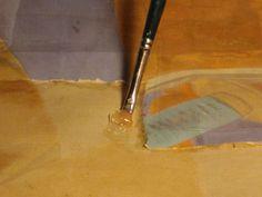 Aplicació d'humitat controlada a través d'un gel per tal d'estovar el paper engomat a la seda
