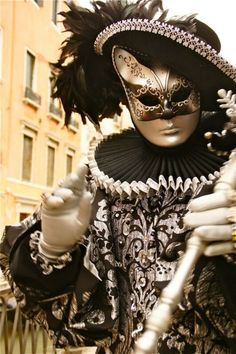 A common Venetian mask is the Gnaga, part of a costume worn by men disguised as women. The traditional Gnaga outfit includes female clothing and a mask portraying a female cat. It was often worn with a basket under the arm, which usually contained a little kitten. The person wearing the costume would usually behave like a plebeian courtesan, uttering acute sounds and mocking meows. -