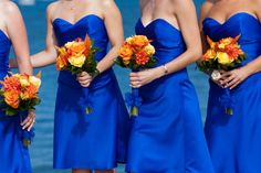 Pretty contrast: Fall color flowers with cobalt blue dresses.