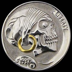 A beautiful skull coin with gold inlay by Amy Armstrong