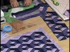 Get this gorgeous quilt pattern here: http://www.kayewood.com/item/Stacking_My_Blocks_Quilt_Pattern/259  A stunning 3-Dimensional quilt made from dark, medium and light fabrics, that Kaye Wood has simplified with her cutting and sewing techniques. Strip sets are cut into topless triangles and then sewn into rows and joined together. Pieced with a...