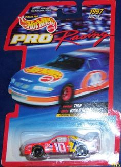 """Hot Wheels 1998 Pro Racing: #10 Ricky Rudd by Mattel. $12.62. Ricky Rudd. 1:64 die cast. Hot Wheels Pro-Racing. Nascar. Hot Wheels 1998 Pro Racing Ford Taurus body is orange, yellow and white with Tide, """"10,"""" Downy & Dawn tampos, black 7sp """"Goodyear Eagle"""" tires, detailed white interior and gray China plastic base."""
