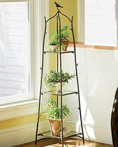 Iron Plant Stand-we love the little bird on top! Reminds us of our Steel and iron Bird Bed.