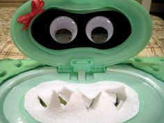 Storage Solutions from Baby Wipe Containers- Use as a napkin dispenser at a monster themed Halloween party.