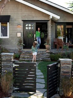 Great flagstone patio, nice gate, cool front door, and cozy flagstone walkway with green growing between the stones. Seems like the lawn mig...