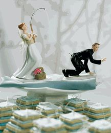 You're Hooked! Fun wedding cake topper for a fishing couple....there's more than one fishing inspired wedding cake topper available. This one shows the bride as the angler and she's got herself a pretty big catch........it's the groom!