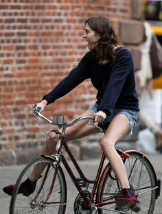 Alexa Chung seen riding her bicycle after lunch with few female friends in SoHo, New York City