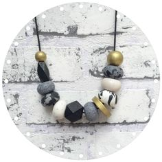Mono Metallic - Handmade Clay and Geometric Bead Necklace by WithLoveCreated on Etsy https://www.etsy.com/listing/219524189/mono-metallic-handmade-clay-and