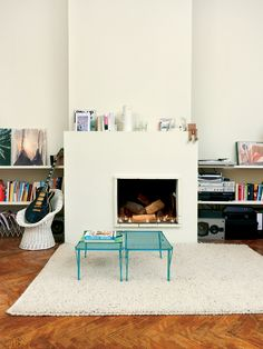 love the off-centre fireplace and mantel