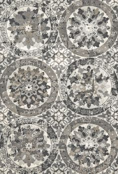 The Sorel Collection's basic palette belies the complexity of its designs. Transitional and contemporary patterns range from erased ikats to kaleidoscope images to large-scale stylized florals. Each design is masterfully power loomed in a palette of grays, taupes and black, and is intricately shaded to impart movement. #interiordesign #decor #rug #floor #grey #pattern