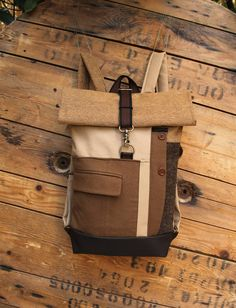 Beige and brown upcycled roll top backpack using parts from a men's suit jacket, brand new textiles and cork fabric, by 'eating the goober' Top Backpacks, Bicycle Bag, Cork Fabric, Rings Online, Brown Jacket, Mens Suits, Bag Making, Gifts For Him, Upcycle