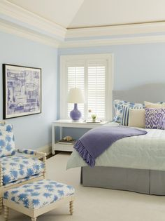 Feels like a vacation home. Amanda Nisbet Design - bedrooms - blue and gray, blue bedroom, blue paint, blue walls, vaulted ceiling, gray headboard, camelback headboard, gray camelback headboard, purple lamp, purple gourd lamp, purple ikat pillow, white nightstand, white chinoiserie table, gray bed skirt, spool chair, spool ottoman.
