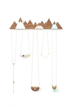 Beautiful wall-mounted jewelry display, portraying a snowy mountain ridge, inspired by Scandinavian design and scenery. Can be easily hung on the wall using two nails. Use it to display your pretty treasures or as a decorative element on its own. Will make an amazing gift! Materials: