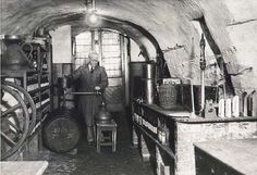 """The Store"" – Fredrick William Barrie Turnbull, John's father, siphoning whisky from a cask before the process of blending in the cellar of 51 High Street Hawick, circa Malt Whisky, British Isles, Cellar, Scotch, Whiskey, Ale, Scotland, Places To Visit, Father"