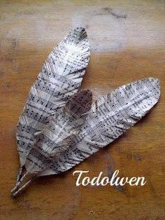 Create feathers from books using craft wire, book pages, scissors, and glue. Beautiful and unique.