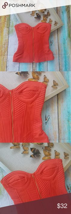 Asos Orange Quilted Strapless Bustier Top 6 Eye catching red-orange color. Fitted bustier silhouette. Strapless neckline with gold zipper front. Quilted texture creates flattering seamlines.  Mesh panels throughout but it is not sheer. In good condition. Made by Asos, size 6 Asos Tops Blouses