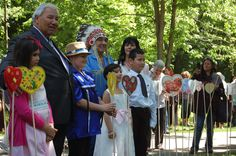 TRC Chair Justice Sinclair and Commissioner Chief Wilton Littlechild are joined by their families to plant hearts in the gardens of Rideau Hall in Ottawa on June 3, 2015.