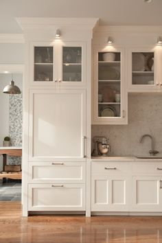 simons hardware Traditional Kitchen Remodelling ideas New York Built-in refrigerator with panels down lights glass cabinet doors marble… White Kitchen Cabinets, Kitchen Cabinetry, Kitchen Redo, Kitchen Pantry, New Kitchen, Shaker Cabinets, Kitchen Ideas, Cupboards, Kitchen Soffit
