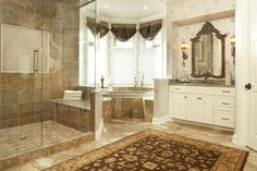 Curtains/ shades, mirror frame color, rug, sconces.  Shadywood Road Residence Master Bathroom traditional bathroom