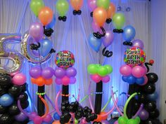 I love the neon!  For a 50th birthday, this is a great design created by a fellow balloon artist, Amy Cullen.