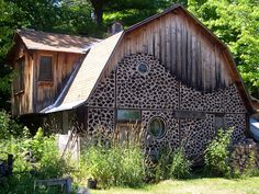 Cordwood Home  Round windows add charming details to this cordwood-style home in Wisconsin.