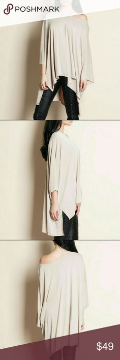 ♥ON SALE! Oversized hi low tee Casual and flowy oversized hi low tee in beige. Rayon/poly blend. Throw on, go anywhere and still look glam tee Tops Tees - Short Sleeve
