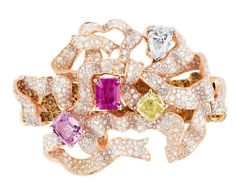 DIOR Bracelet ~ 18k pink, yellow and white gold, diamonds, and orange, yellow diamonds and pink sapphires