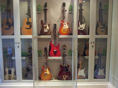 Guitar Storage Cabinet Case Diy Inviting For 13 Interior Home Ideas Guitar Display Case, Guitar Storage, Home Music Rooms, Home Studio Music, Guitar Wall, Guitar Room, Plug In Hanging Light, Guitar Cabinet, Vintage Electric Guitars