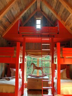 Red Bunk Room  Five bright-red beds make up this whimsical bunk room. A wooden peaked roof and large open windows provide stunning outdoor views and an adventurous indoor camping experience.