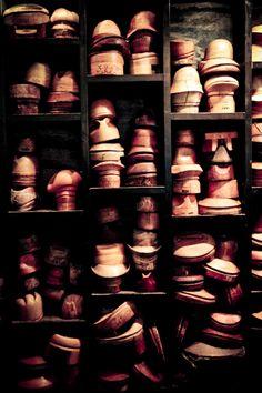 Victor Osborne wall of hat molds . . .*