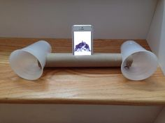 Build your own iPhone speakers with a roll and two beer cups