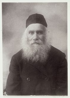 "Photo of Reb Arieh-Leib ""der Rubishker"" (from Rubishok) Kudlanski, Eisiskes' milkman.   Every Saturday morning, he used to walk to the shtetl's Old Beth Midrash in his prayer shawl.  When he passed by, Christian and Muslim farmers removed their hats in his honor. All of his children immigrated to America.  He visited them but decided to return to Eisiskes stating that he did not like a country ""where people love more the people who walk on the walls [people in the movies] than real people…"