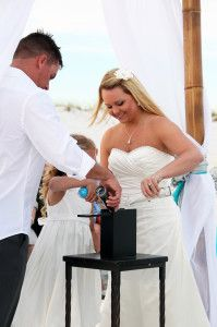 Beach Wedding Sand Ceremony- Such a cool idea for blending your families together.